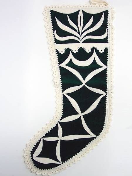 <div>Hand-cut reverse felt applique stocking on velvet.</div>: