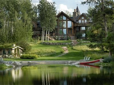 The property of this 12,000 Sq Ft. Log Home on over 30 Acres is a DREAM.