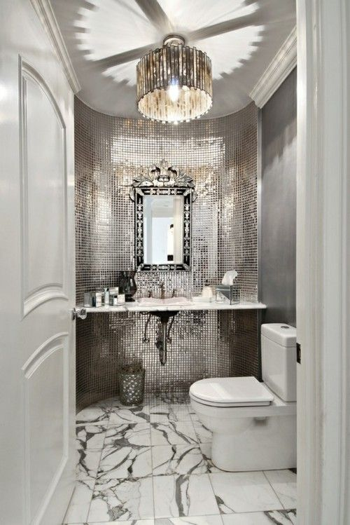 POWDER ROOM Gorgeous luxurious mirror and tile in bathroom interior: