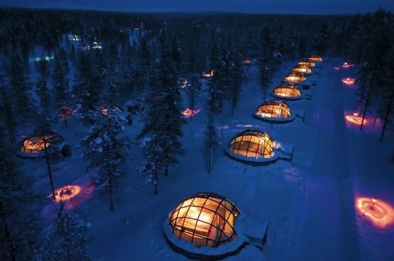 Kakslutannen glass igloos with views of the Northern Lights in Lapland, Finland.