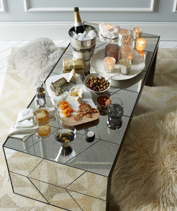 "No windows in your living room?     Mirrored furniture and accessories – like this Herringbone Mirror Coffee Table – are an alternative way to reflect light + add a little glamorous detail."":"