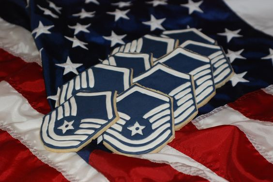 hand cut and hand decorated sugar cookies made in the shape of a master sergeant stripe. (military, Air Force)