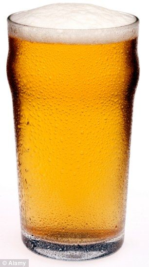 Healthy pint: Beer is rich in calcium so could benefit your bones, and full or minerals and vitamins