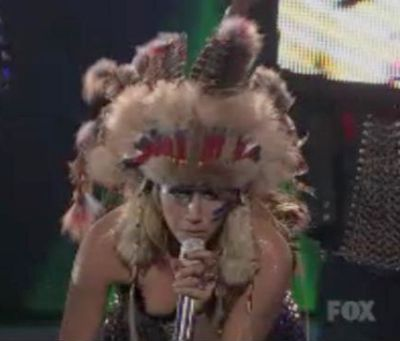 """Even those who have no interest in American Indian culture gave this outfit a hearty whaaaa…? when Ke$ha wore it on American Idol. And then they proceeded to rip her showmanship. Newsday blogger Jamshid Mousavinezhad wrote a post titled """"Kesha Annoys Us All on American Idol"""" in which declared it """"a train wreck of a performance."""""""