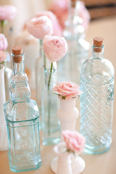 Blue glass. Pink flowers.
