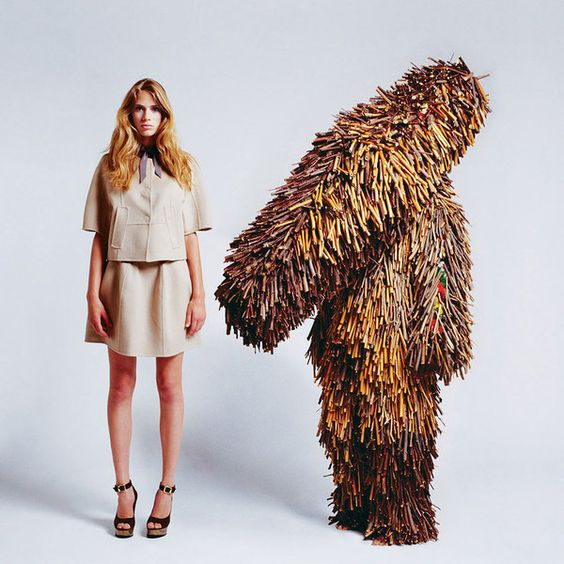 via Trendland -juxtaposes fall fashion of Creature Couture (photographed by Ted Sabarese) with the imaginative sculpture of artist Nick Cave.   http://trendland.com/creature-couture-by-ted-sabarese-sculpture-by-nick-cave/