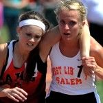 High school track star helps a competitor finish her race.