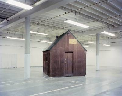 Unabomber 01 by Richard Barnes, 1998, Photograph of Ted Kaczynski's cabin while being stored in FBI warehouse.