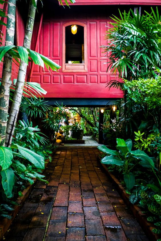 Walking around in the gardens of the Jim Thomson House in Bangkok Thailand. *