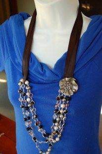 Using a ribbon, Opulence necklace and a pin, another creative look. Carolyn Popp Premier Designs Jewelry on Facebook.