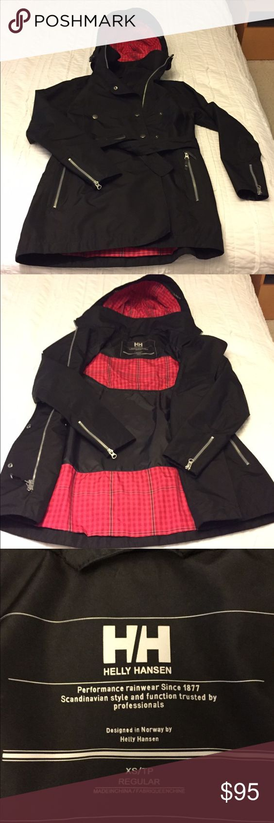 Helly Hansen Rain Jacket Helly Hansen trench style rain jacket. Belted. Hooded. Zippers at pockets and sleeves. Waterproof. Black with pink and red plaid details. Excellent condition, no flaws. Ordered from Nordstrom. Helly Hansen Jackets & Coats Trench Coats