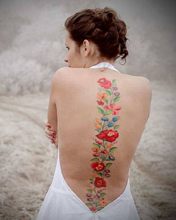 Have a garden of beautiful flowers on your back. Each flower could have a different meaning and all these could also represent who you are as a person.
