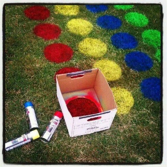 Such a coo idea. Spray painting twister on the grass. Even more fun for a kids summer birthday party!