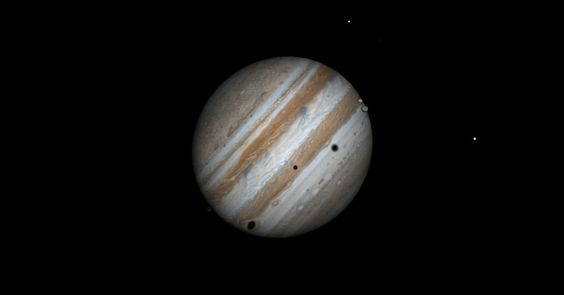 In this computer simulation, three of Jupiter%u2019s moons cast their shadows on the face of Jupiter as they will appear on the afternoon of June 3.