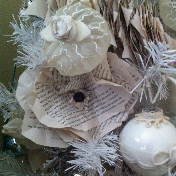 Paper flowers made out of old books, help give this tree a great vintage look!