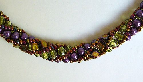 Russian spiral using 11/0 metallic gold iris, 4 mm metallic gold iris cubes, 4 mm peridot fp & 4 mm purple pearls.   For PDF tute: http://www.beadpatterncentral.com/russianspiral.pdf     #Seed #Bead #Tutorial