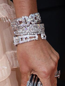 Stacked Cartier bracelets