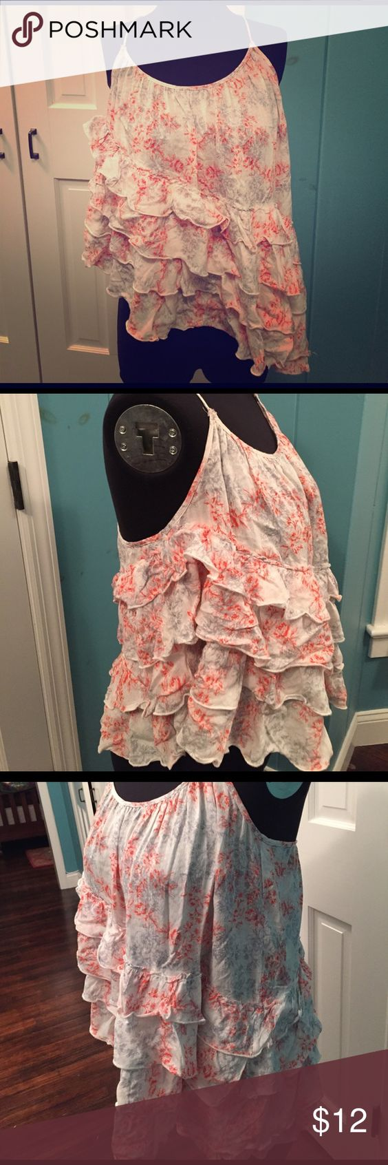 Free people floral asymmetrical ruffle top M So cute. Never worn. Crisscross straps, adjustable. Layers of ruffles. Longer on one side. Free People Tops Camisoles