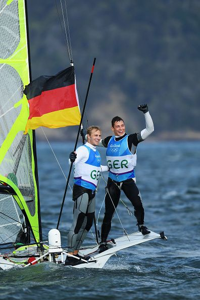 Erik Heil of Germany and Thomas Ploessel of Germany celebrate after winning the…