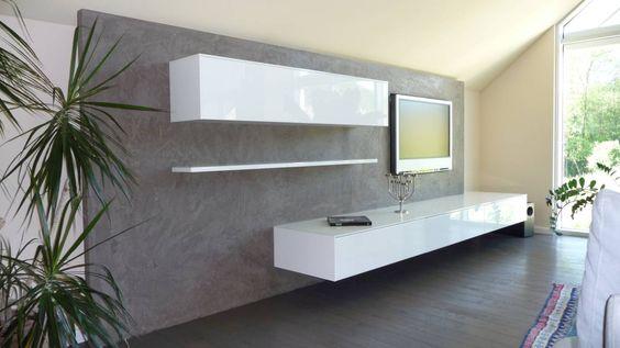 Steinwand mit Textur in grau hinter Wohnwand Wohnideen - steinwand wohnzimmer schwarz