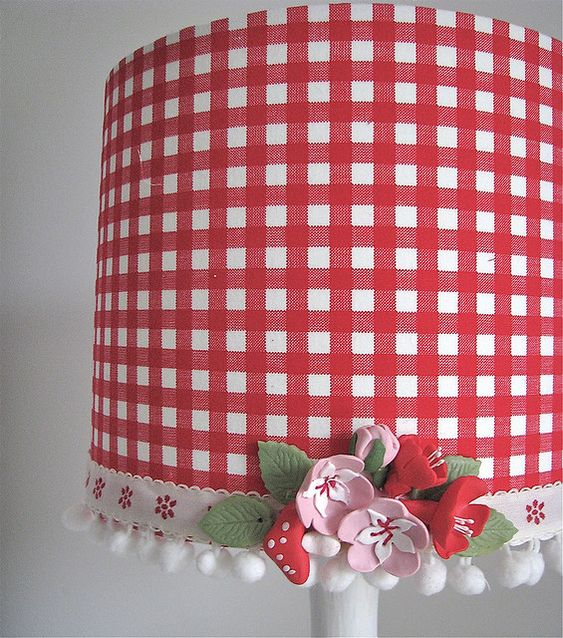 Gingham lampshade - like the idea of adding flowers and ribbon onto a shade after you put material over it