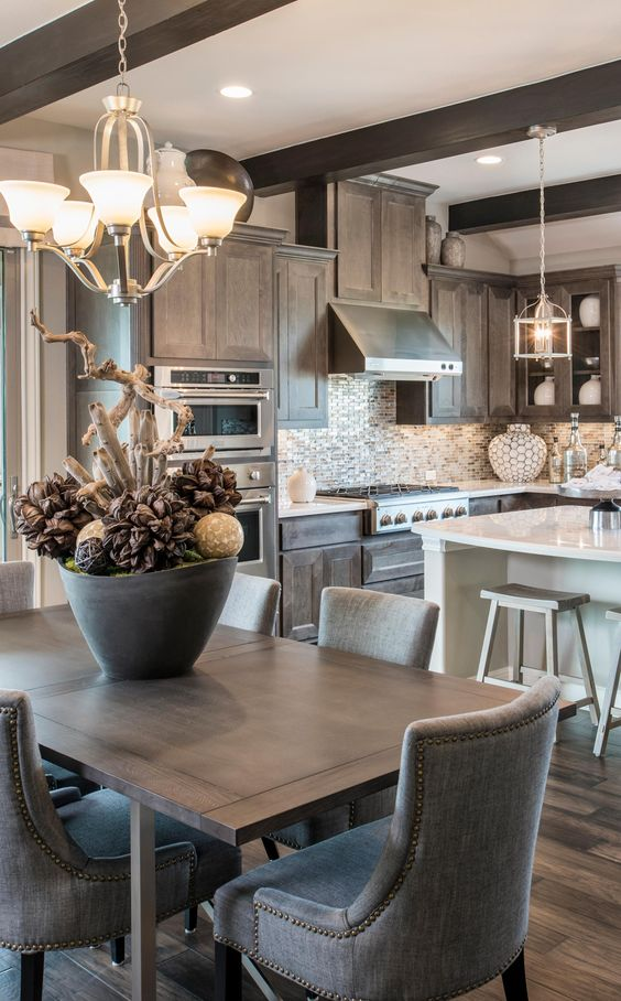 Treat your guests to a beautiful dining experience in your new Hill Country home. #diningtable #centerpiece #kitchen