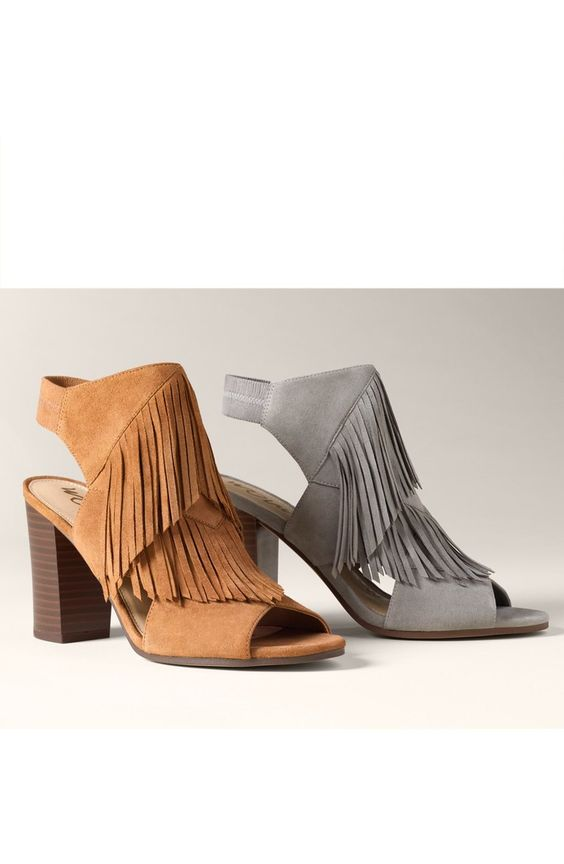 New favorites! Tiered fringe adds a dramatic Western flourish to these open-toe sandals from Sam Edelman.