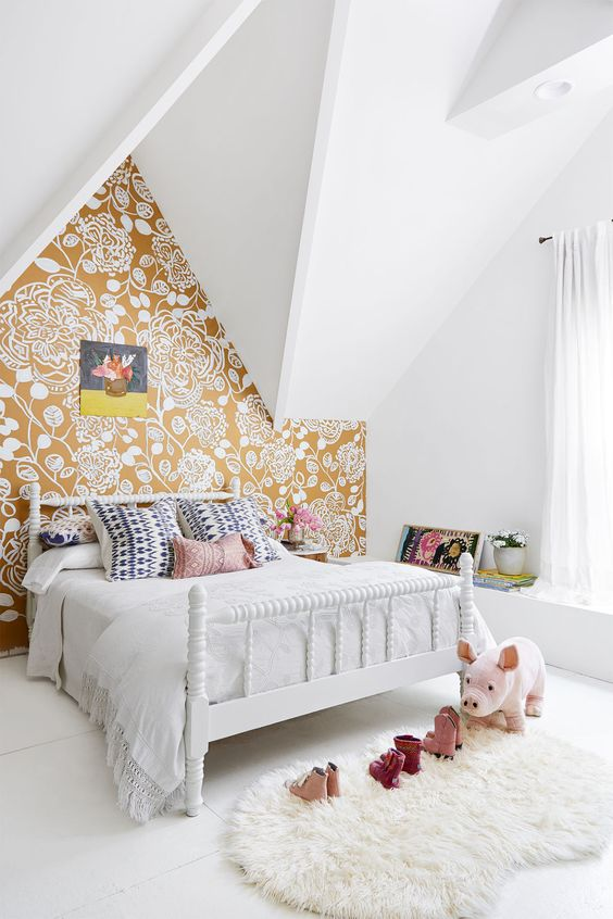 Pretty floral wallpaper feature wall in girls room