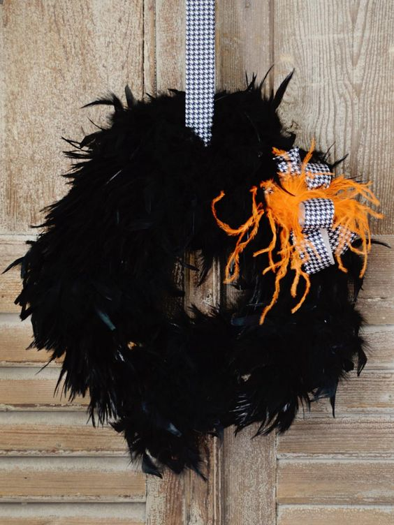 Glam up your front door with an over-the-top black feather wreath. Use feathers in a contrasting color and menswear-inspired ribbon for a fashion-forward embellishment. Get crafting to make your own.