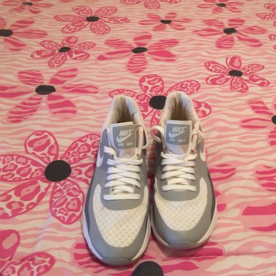 Women's Nike Air Max Used pair of sneakers. They have been cleaned. There is some small light spots on the front of the sneaker. Nike Shoes Sneakers