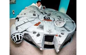 Kayla Kromer, a 26-year-old first grade teacher from Austin, Texas, dressed as Princess Leia, lies in her Millennium Falcon bed
