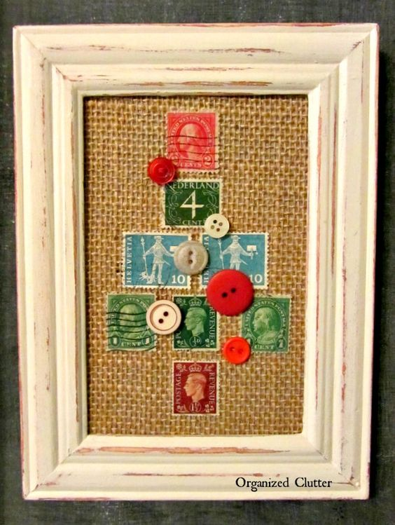 A cute Christmas tree made with some old postage stamps decorated with buttons!