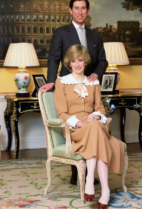 Princess Diana and Prince Charles situate themselves for a picture at home in Kensington Palace.