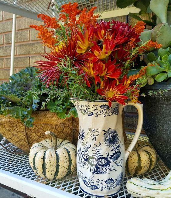 gorgeous outdoor fall vignette with fresh grocery store flowers, autumn kale and succulents