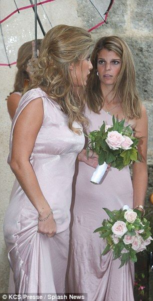 9-14-13.  Brr! Onassis took shelter with the other bridesmaids as she waited outside the church