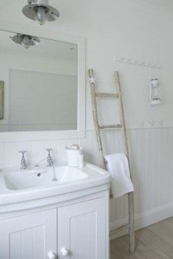 Make a ladder out of thin logs, paint it,  and use it as a towel holder!