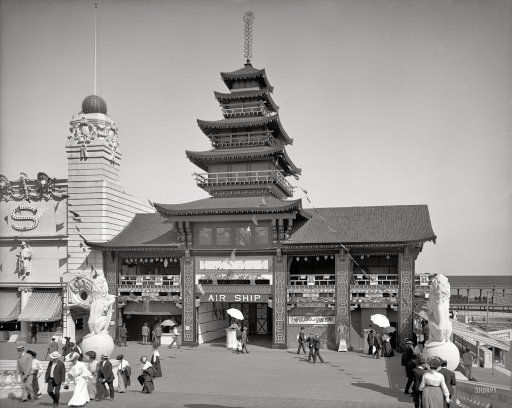 """New York circa 1904. """"Dreamland Park, Air Ship Building, Coney Island."""" Step right up to see the Santos-Dumont Airship No. 9 -- only a dime. Extra added Axis-flavored attraction: swastika decorations on this Japanese pagoda, the """"Revels of Japan"""" tea house; the airship was in a hangar out back."""