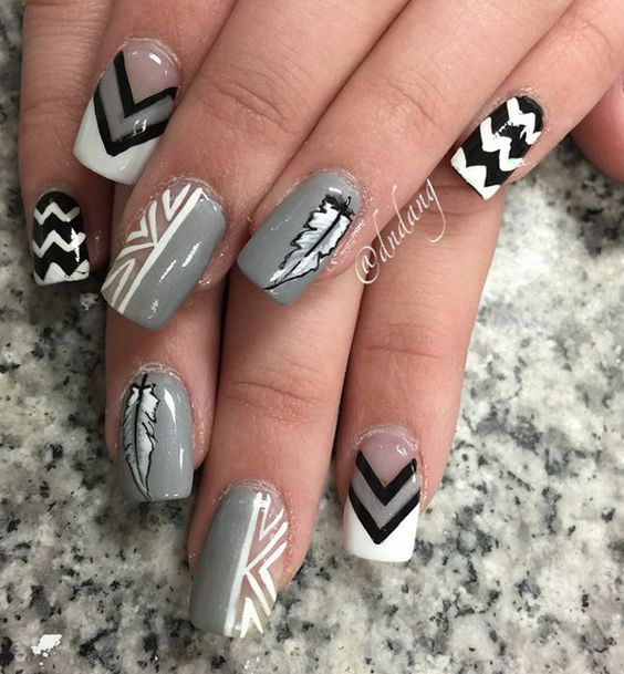 Perfect winter nail art design. Use winter hues such as black, gray and white to create tribal images and designs on your nails.