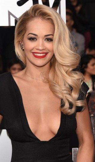 If you want to blow everyone at your next party, try recreating Rita Ora's alluring hairstyle. For the singer's gorgeous look, blow dry hair in sections, curl it around a large brush.