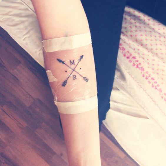 New tattoo ❤️ crossed arrow tattoo