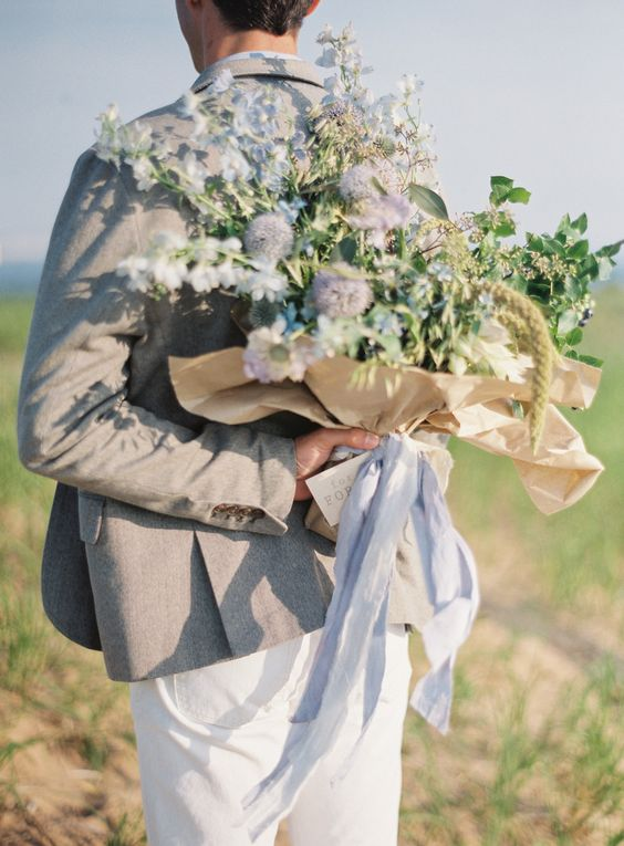 Bouquet of wildflowers | Photography: Weber Photography- Cory Weber - weber-photography.com  Read More: http://www.stylemepretty.com/2015/04/22/south-manitou-island-anniversary-session/