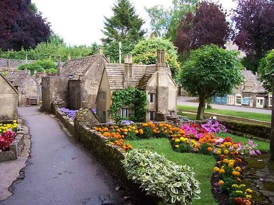 "The miniature village is located in the garden of ""The Old New Inn"" in Bourton-on-the-Water."