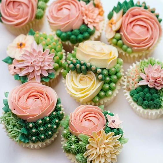 Cupcakes decorated with Swiss Meringue Buttercream flowers and succulents.