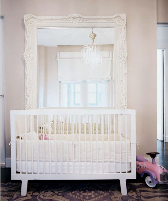 Just about any small space can be helped along by hanging a mirror. It opens up the space and reflects light around, making a cramped room feel a little spatial relief. But in a nursery, a mirror does that and so, so much more:    It's a toy. Babies are infinitely entertained by seeing themselves in the mirror. Point them out to themselves and they'll laugh and smile. So fun!
