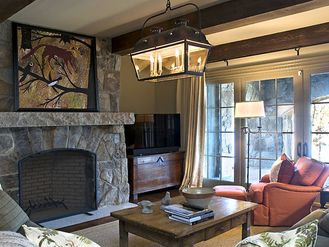 Beautiful Rustic Family Room Stone Fireplace Old World Lakehouse www.bedhomes.com