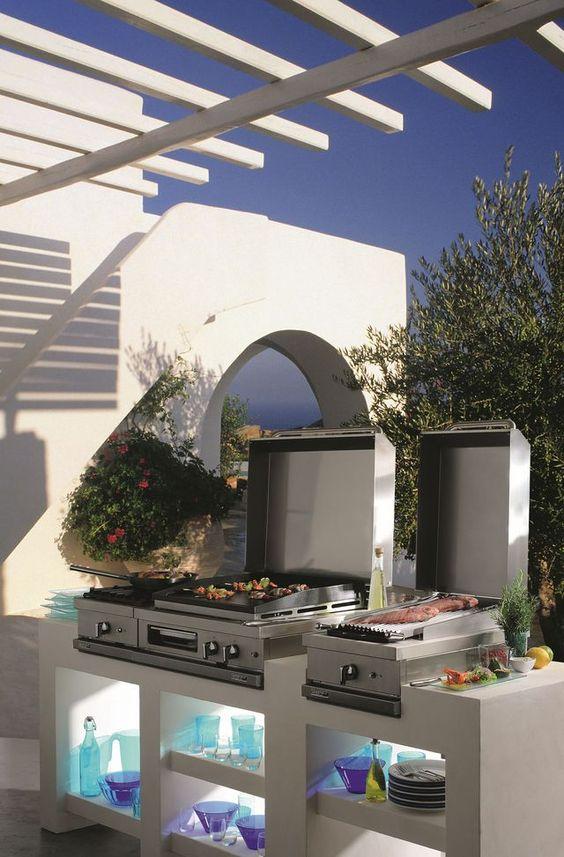 Cuisine Open'Cook avec modules variables. Inox et fonte émaillée. Foyers gaz. Grils à pierres de lave. Planchas. À partir de 850…