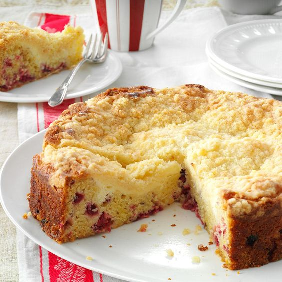 Creamy Cranberry Coffee Cake Recipe -Chopped cranberries and orange peel give this coffee cake bursts of tart flavor, but a cream cheese layer on top sweetens it nicely. It's so lovely, you'll want to serve it when company comes. -Nancy Roper, Etobicoke, Ontario