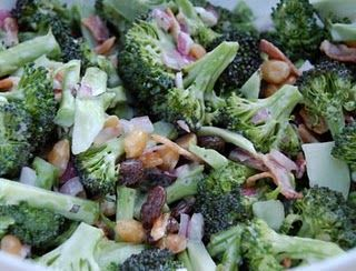 2 heads of fresh broccoli 1/4 cup of red onion, chopped 1/2 lb bacon, cooked and crumbled 1/2 cup raisins (or craisins) 1/2 cup sunflower seeds 2 1/2 tablespoons vinegar 1 cup mayo 1/3 cup sugar 1 1/2 grated cups mozzarella  Chop up tops of broccoli (no stems) into bite size pieces. Mix broccoli, onions, bacon, mozzarella, raisins, and seeds. In a separate bowl mix mayo, sugar and vinegar. Pour over salad and toss to coat. Best made a day ahead so the flavors can combine.