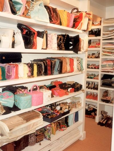 bags and purses in a walk in closet.