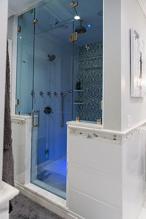 Outdated no longer! A stale bathing unit gets a major overhaul with glass and marble, creating a modern look. Arizona's Realty